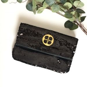 Fold over Black sequin clutch.